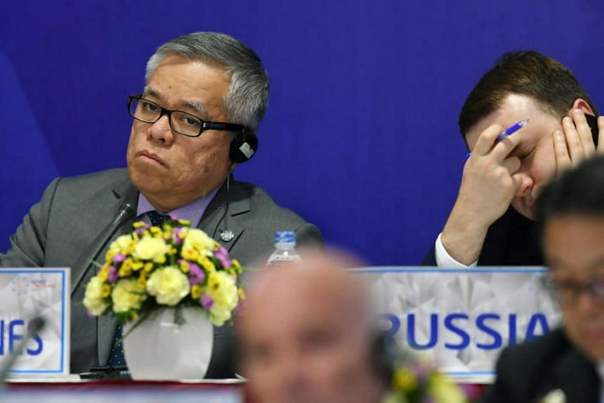 Philippines' Trade Secretary Ramon Lopez (left) listens next to Russian Economic Development Minister Maxim Oreshkin (right) during a joint press conference held on the sideline of the Asia-Pacific Economic Cooperation (APEC)'s 23rd Ministers respons