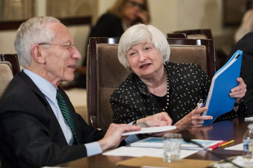 In a letter to President Donald Trump, US Federal Reserve Vice Chair Stanley Fischer (left) said he was resigning for personal reasons and that the effective date would be on or around Oct. 13.
