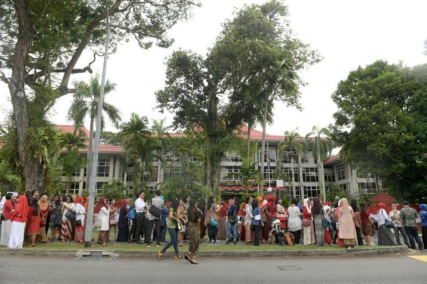 People queueing outside the Indonesian embassy to meet President Jokowi in Singapore on Wednesday evening.