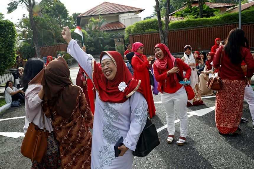 A group of domestic helpers, who took one-day leave to see Indonesian President Joko Widodo, arrive outside the Indonesian embassy in Singapore on Sept 6, 2017.