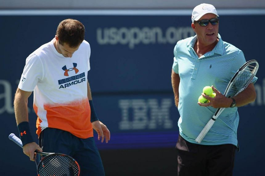 Andy Murray of Great Britian shows his frustrations as his coach Ivan Lendl looks on before withdrawing from the event during a practice session prior to the US Open Tennis Championships at USTA Billie Jean King National Tennis Center on Aug 26, 2017