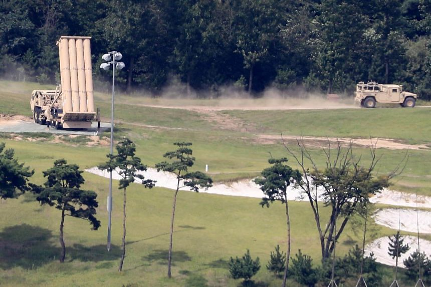A U.S. military vehicle drives past a launcher of a Terminal High Altitude Area Defense (Thaad) system, in Seongju, South Korea on Sept 4, 2017.