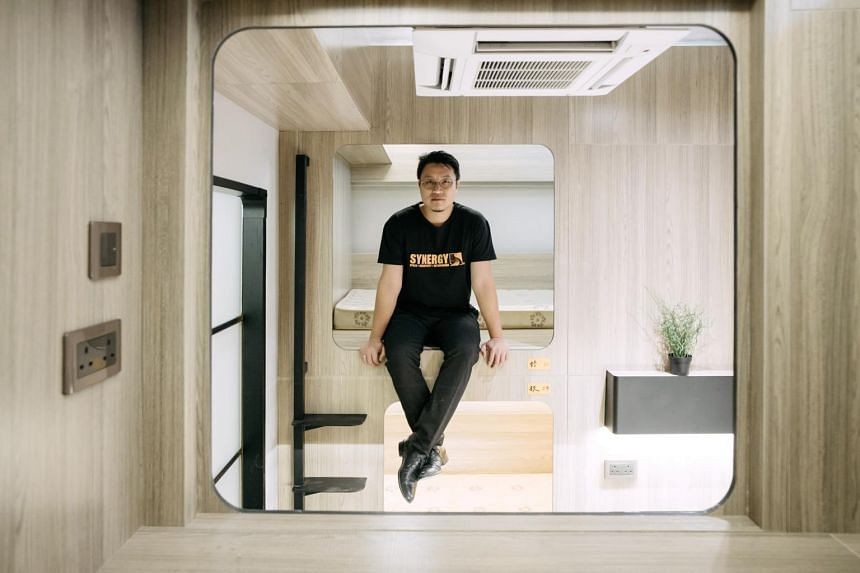 Mr Keith Wong, the co-founder of Synergy Biz Group, sitting on a bunk bed inside a room at the company's Bibliotheque co-living development in the Yau Ma Tei district of Hong Kong, China, on Aug 29, 2017.