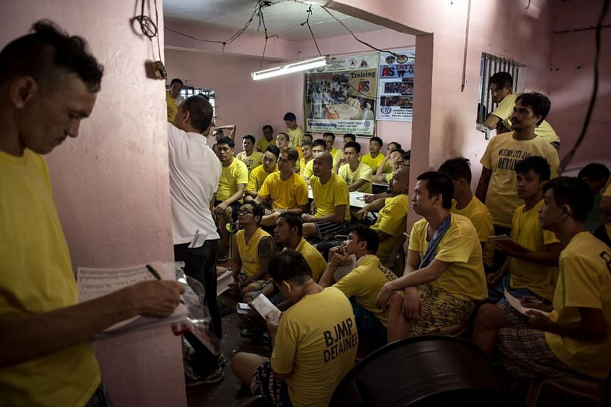 Inmates attending a basic electrical wiring course inside the Quezon City Jail in Manila, on July 11, 2017.