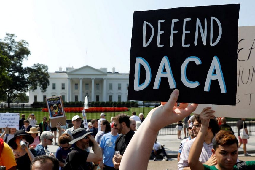 Demonstrators protest in front of the White House, after the Trump administration scrapped the Deferred Action for Childhood Arrivals in Washington, US, on Sept 5, 2017.