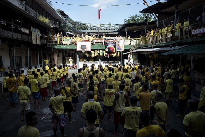 Inmates attending a flag raising ceremony inside the Quezon City Jail in Manila, on July 11, 2017.