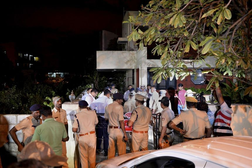 Home Minister of the South Indian state of Karnataka, Ramalinga Reddy along with senior police officials visiting the house of 55-year-old Gauri Lankesh, who was shot dead by unknown assailants in the porch of her home in Bangalore, on Sept 5, 2017.
