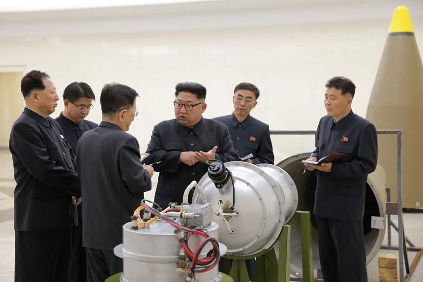 North Korean leader Kim Jong Un provides guidance on a nuclear weapons program in this undated photo released by North Korea's Korean Central News Agency (KCNA) in Pyongyang on Sept 3, 2017.