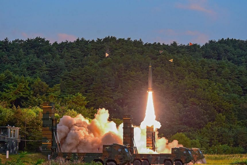 A handout photo made available by the South Korea Defense Ministry shows a Hyunmoo-2 missile being launched at an undisclosed location on the east coast of South Korea, on Sept 4, 2017.