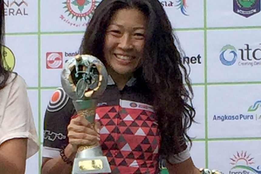 Singapore cyclist Shirley Teo with her GFNY Indonesia trophy. She won the overall female title and a spot in next year's final race in New York.
