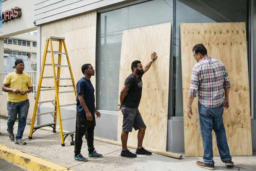 A bar is boarded up in preparation for Hurricane Irma in the Santurce district of San Juan, Puerto Rico, Sept 6, 2017.