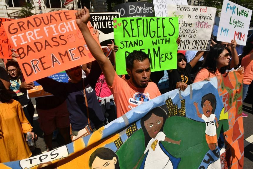 Immigrants and supporters demonstrate during a rally in support of the Deferred Action for Childhood Arrivals (Daca) programme in front of the Trump International Hotel, on Sept 5, 2017, in Washington DC.
