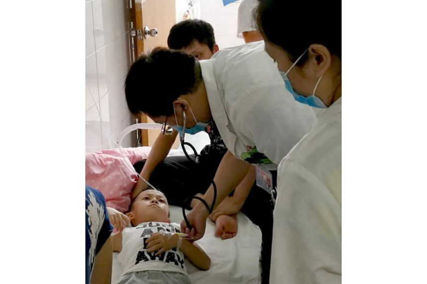 Medical personnel at Jiangxi Provincial Children's Hospital in Nanchang, Jiangxi province, treating a boy on Wednesday (Sept 6).