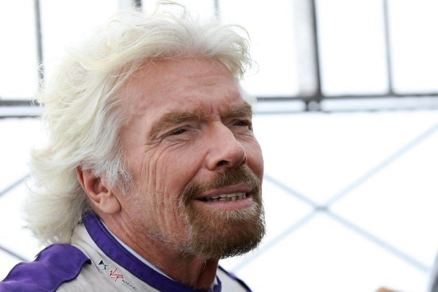 Richard Branson poses at the Empire State Building to promote the DS Virgin Racing team and The New York City ePrix in New York City, on July 14, 2017.