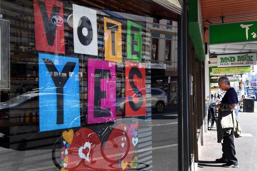 A Vote Yes sign is seen in a shop window supporting same-sex marriage in Sydney, on Sept 7, 2017.
