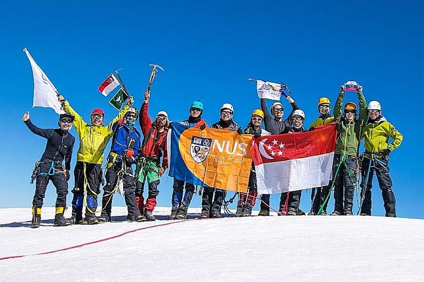 The NUS team, standing tall, comprises (from left) Mr Ong Tze Boon, guides Lim Kim Boon and Edwin Siew, Kazakhstani guide Saken, mountaineers Jovi Loo, Leong Chi Yang, Pang Hui En, Lim Yi Xiang, Nur Hazirah Hassan, Jonathan Yee, Dmitrii Kharkovskii a