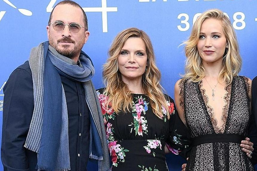 (From left) Director Darren Aronofsky with actresses Michelle Pfeiffer and Jennifer Lawrence, who star in mother!, at the Venice Film Festival on Tuesday.