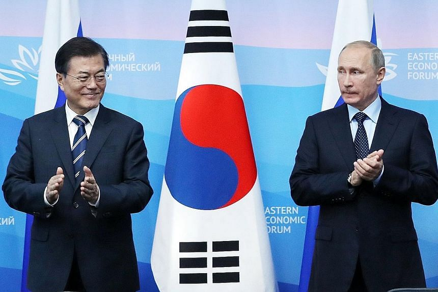 South Korean President Moon Jae In and his Russian counterpart Vladimir Putin in Vladivostok yesterday.