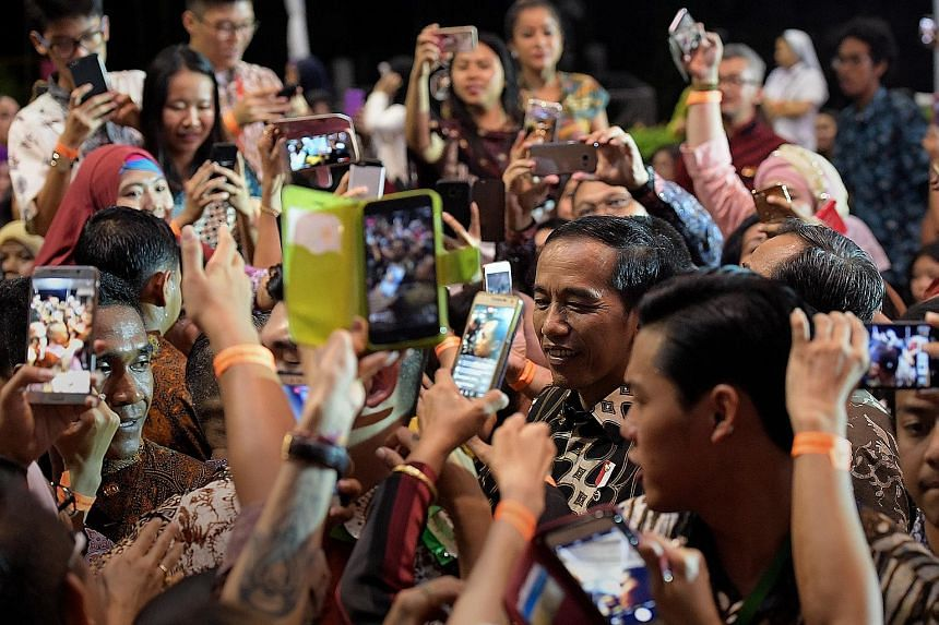 Indonesian President Joko Widodo greeting the crowd at the Indonesian Embassy in Chatsworth Road yesterday. Many queued for hours to catch a glimpse of Mr Joko, who will attend a Leaders' Retreat with Prime Minister Lee Hsien Loong today, as Singapor