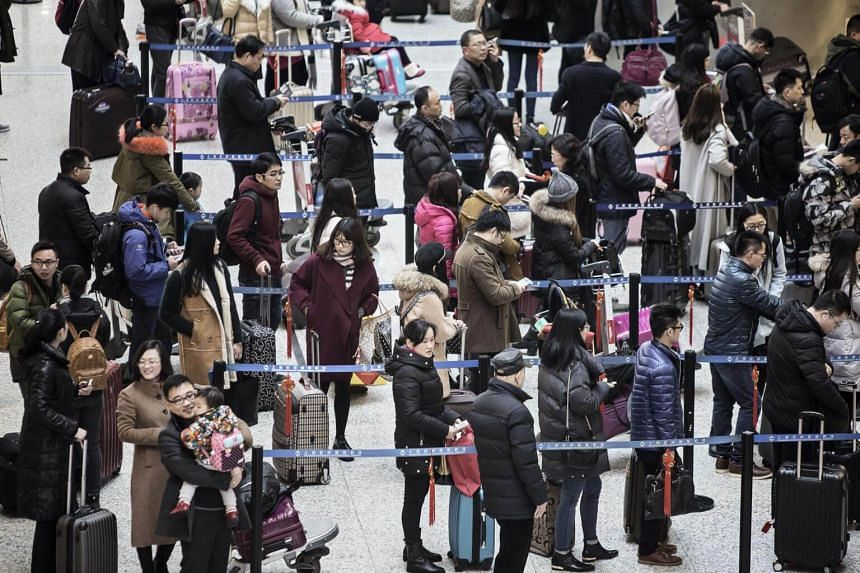 Travelers waiting in line at airline check-in counters at Shanghai Hongqiao Airport in Shanghai, China, on Feb 5, 2016.