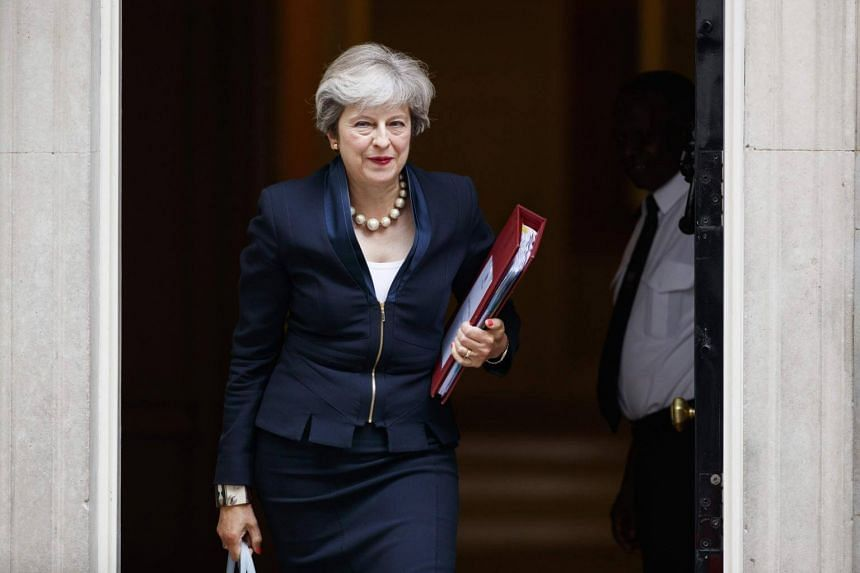 British PM Theresa May leaves 10 Downing Street in central London on Sept 6, 2017, on her way to the Houses of Parliament.