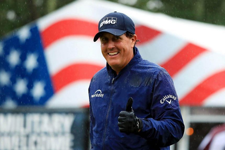 Phil Mickelson walks to the 17th tee during round three of the Dell Technologies Championship on Sept 3, 2017.