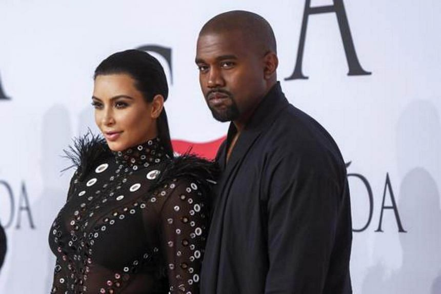 Kim Kardashian arrives with Kanye West at the 2015 CFDA Fashion Awards in New York on June 1, 2015.