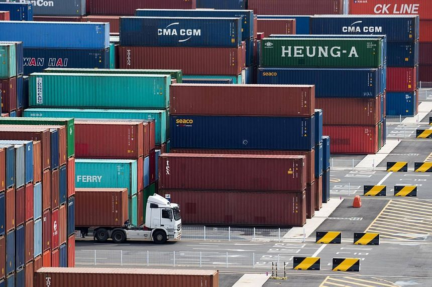 A truck carrying a container at the Sun Kwang Newport Container Terminal (SNCT) in Incheon New Port in South Korea, on Sept 4, 2017.