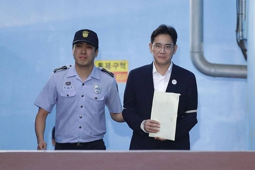Lee Jae Yong, Samsung Group heir, leaves after his verdict trial at the Seoul Central District Court in South Korea, on Aug 25, 2017.