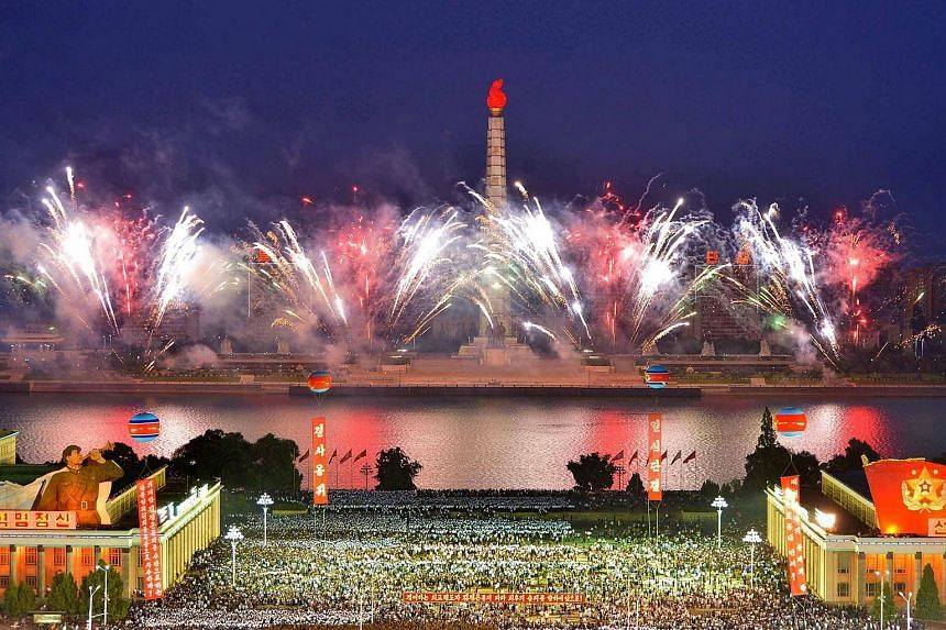 A photo released by North Korea's KCNA agency on Sept 7, 2017, shows fireworks as Pyongyang residents and military personnel celebrate at Kim Ill Sung Square.