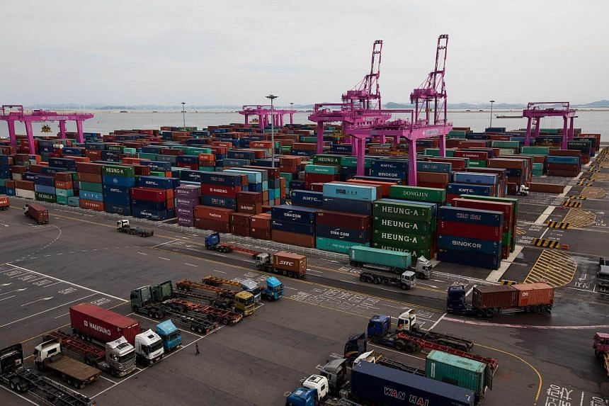 Containers stacked among gantry cranes at the Sun Kwang Newport Container Terminal (SNCT) in Incheon New Port in South Korea, on Sept 4, 2017.