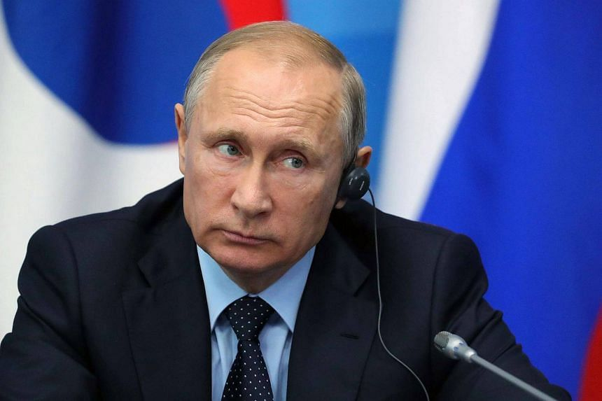 Russian President Vladimir Putin listens as he attends a joint press statement with President of South Korea at Russky Island outside Vladivostok on Sept 6, 2017.