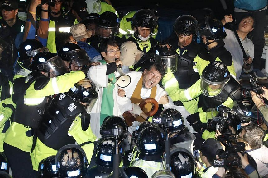 Residents and members of civic and religious groups battle riot police trying to break up their protest.