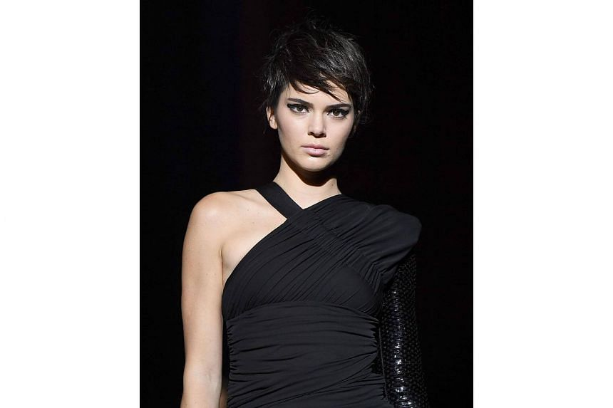 Model Kendall Jenner walks the runway for the Tom Ford SS18 show at Park Avenue Armory on Sept 6, 2017 in New York City.