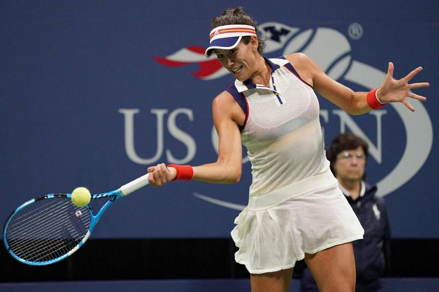 Garbine Mugurusa of Spain hits a return to Petra Kvitova of the Czech Republic during their 2017 US Open Women's Singles match at the USTA Billie Jean King National Tennis Center in New York on Sept 3, 2017.