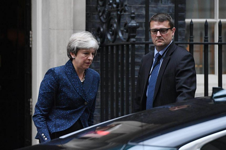 British Prime Minister, Theresa May (left) leaves her London residence, 10 Downing street, in c entral London, Britain to attend a EU withdrawal bill debate in the Britsih Houses of Parliament in Westminster on Sept 7, 2017.