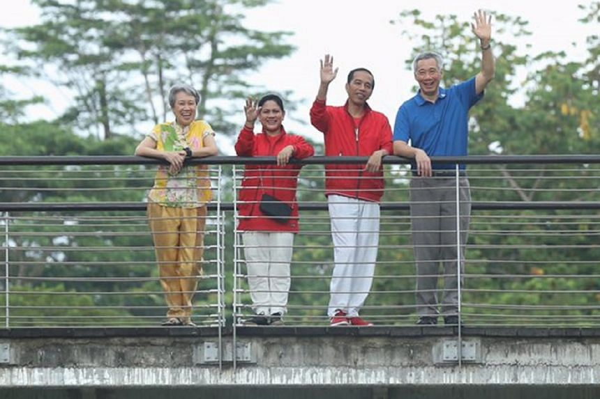 From left: Mrs Lee, First Lady Iriana, President Joko Widodo and PM Lee Hsien Loong wave to the media as they tour the Learning Forest in Singapore Botanic Gardens on Sept 7, 2017.