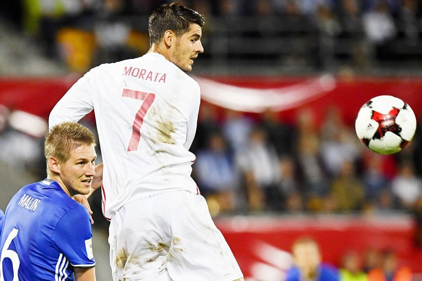 Liechtenstein defender Martin Rechsteiner (far left) and Co will be pleased to see the back of Alvaro Morata and his Spain team-mates after they were routed 8-0 by the visitors.