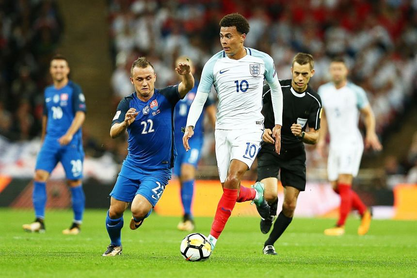 England's Dele Alli in action during the 2-1 win in their World Cup qualifier against Slovakia on Monday. The Football Association believes it can prove that Alli's one-finger salute was not directed at the referee.