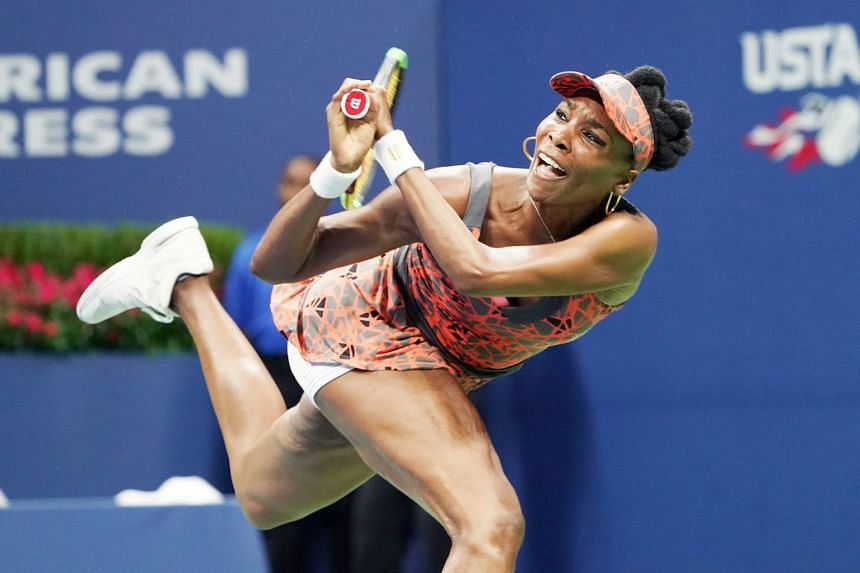 American Venus Williams hitting a backhand to Czech Petra Kvitova during their US Open women's singles clash. Williams, 37, won 6-3, 3-6, 7-6 (7-2) to become the oldest US Open semi-finalist.