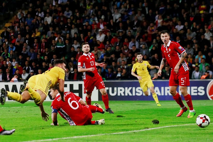 Wales forward Hal Robson-Kanu heads his team into the lead in their World Cup qualifier against Moldova following a cross from substitute Ben Woodburn. Wales went on to win 2-0 to move up to second in Group D.