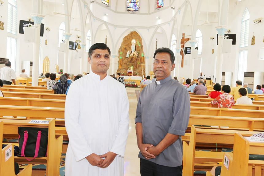 Father Michael Sitaram (in grey), the church's parish priest, with Father Nithiya SagayaRaj, the assistant parish priest, at the Church of Our Lady of Lourdes. The Church of Our Lady of Lourdes' neo-Gothic design was heavily influenced by the archite