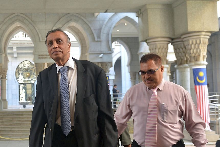 Mr Nor Mohamed Yakcop (left) arriving yesterday to testify at the ongoing Royal Commission of Inquiry (RCI). His testimony was much anticipated as he is seen as a former insider who might name names and unveil more details on the trading losses, said