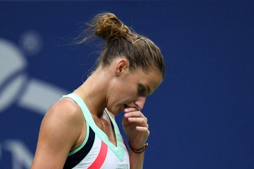 Pliskova reacts to losing a point against CoCo Vandeweghe of the US.
