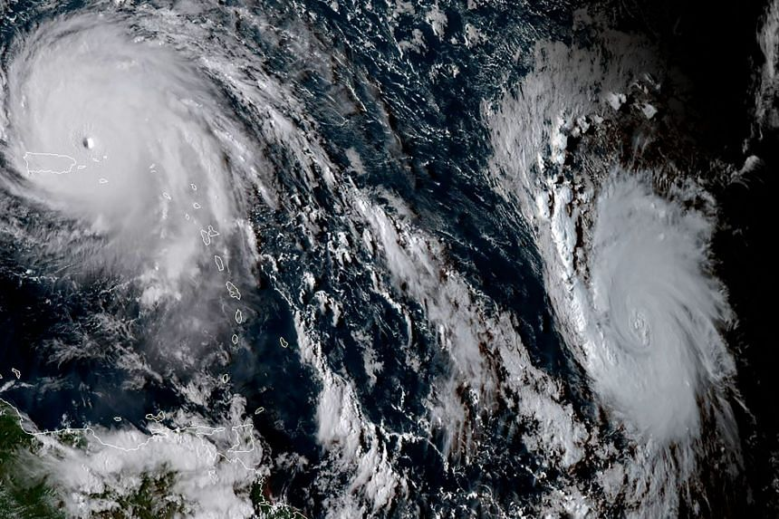 A satellite image shows Hurricanes Irma (left) and Jose (right).