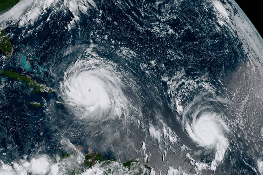 A satellite image shows Hurricane Irma (left) and Hurricane Jose (right) in the Atlantic Ocean on Sept 7, 2017.