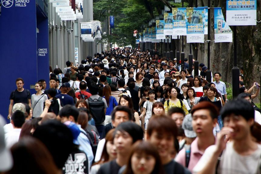 Pedestrians are pictured at a shopping district in Tokyo, Japan, on Aug 14, 2017.