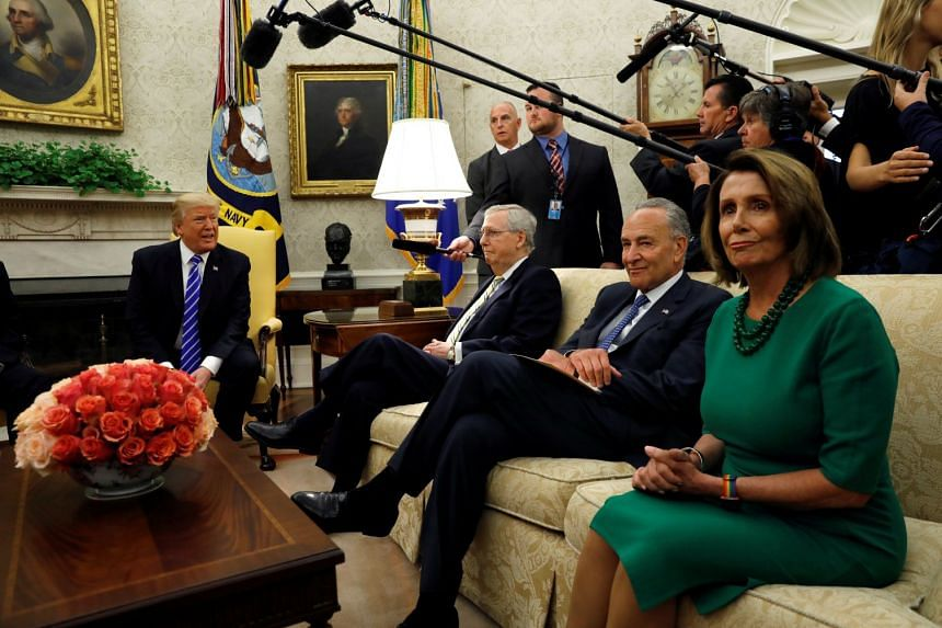 Trump with (from far right)  Pelosi, Schumer and Senate Majority Leader Mitch McConnell on Sept 6, 2017.