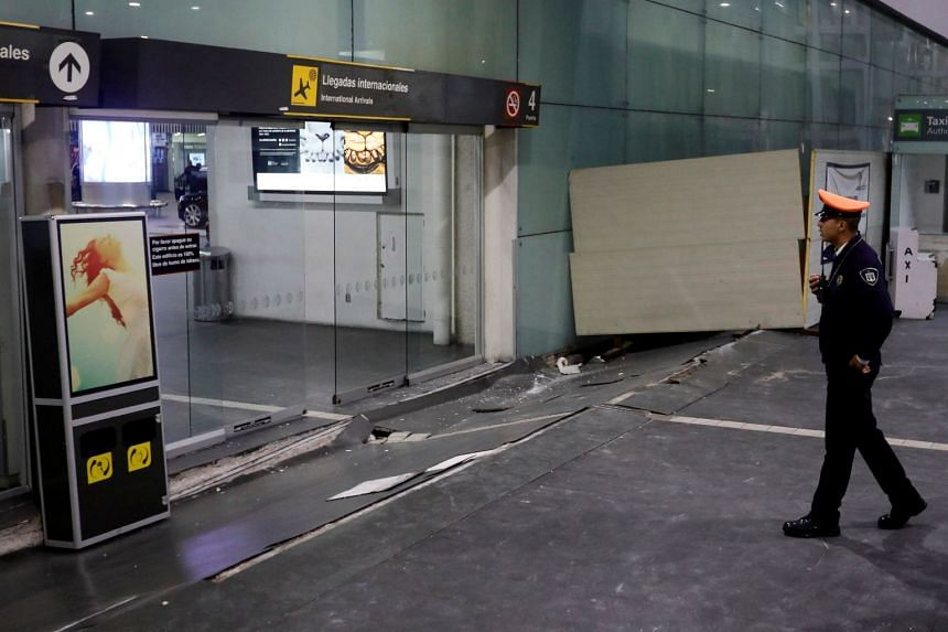 A view of damages on the floor in an entrance of the Benito Juarez international airport after an earthquake hit Mexico City, on Sept 8, 2017.
