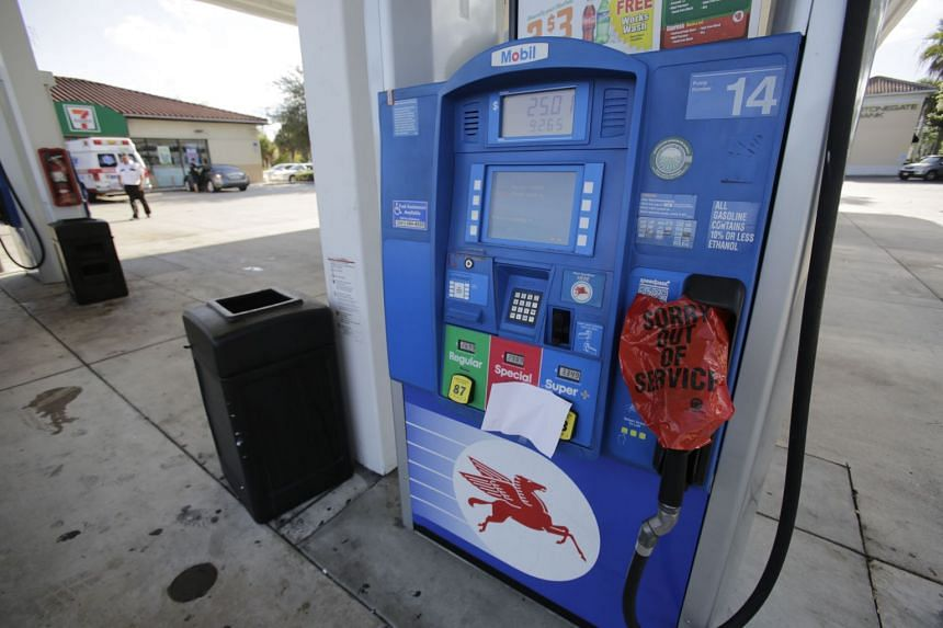 A pump sits covered as no fuel is available at an Exxon Mobil gas station ahead of Hurricane Irma in West Palm Beach, Florida, on Sept 7, 2017.